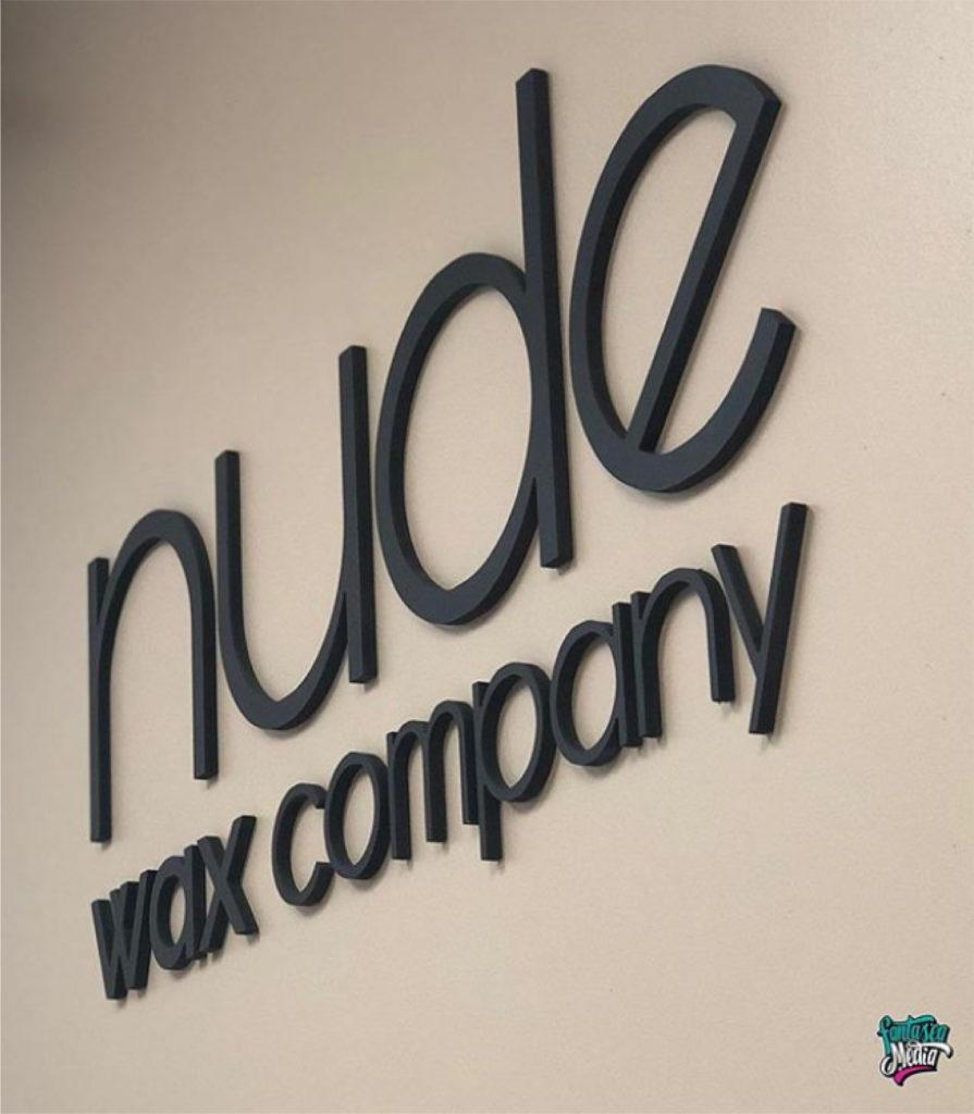 nude wax company interior lobby signage by fantasea media