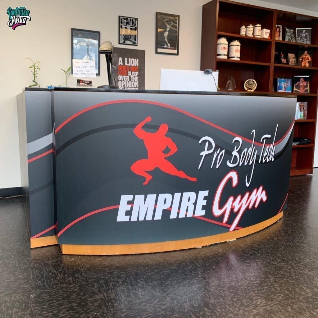 storefront gym wrap graphics installation
