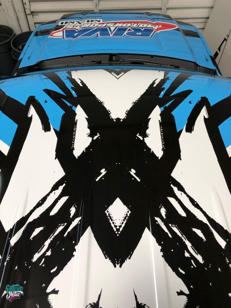 truck hood roof wrap blue black white graphics by fantasea media