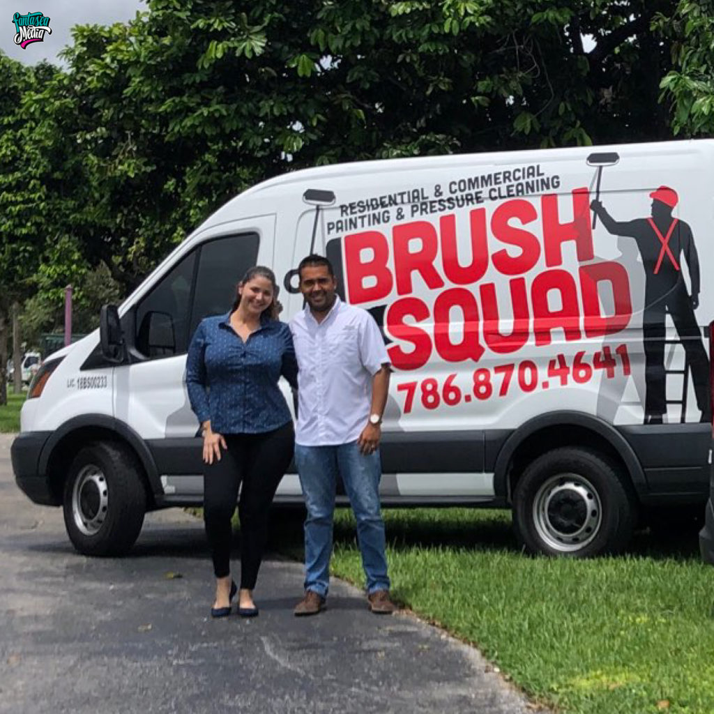 couple standing in front of wrapped car advertising brush squad vehicle wrap